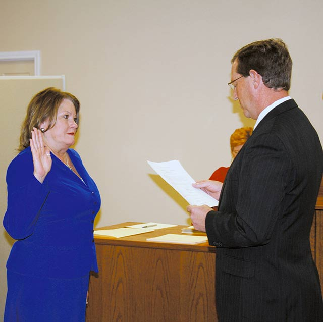 TAKING THE OATH – One of many times, long time Trinity County Clerk, took her oath of office. Pictured here is when she was re-elected into office in the November General Election of 2010. (Photo by Greg Peak)